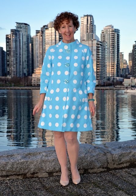 Sue A Colourful Canvas wearing polka dot coat