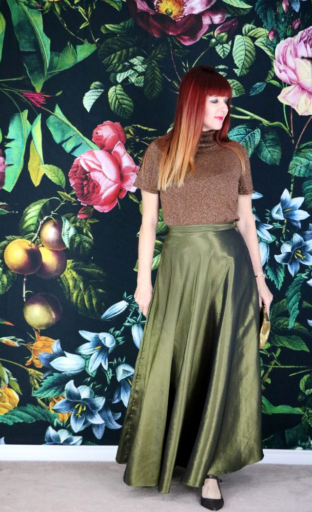 Moss green metallic maxi skirt with bronze sweater. Outfit ideas for the holidays.
