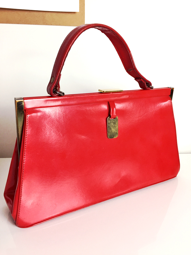 red leather framed vintage handbag