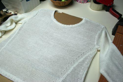 Cardboard in sweater