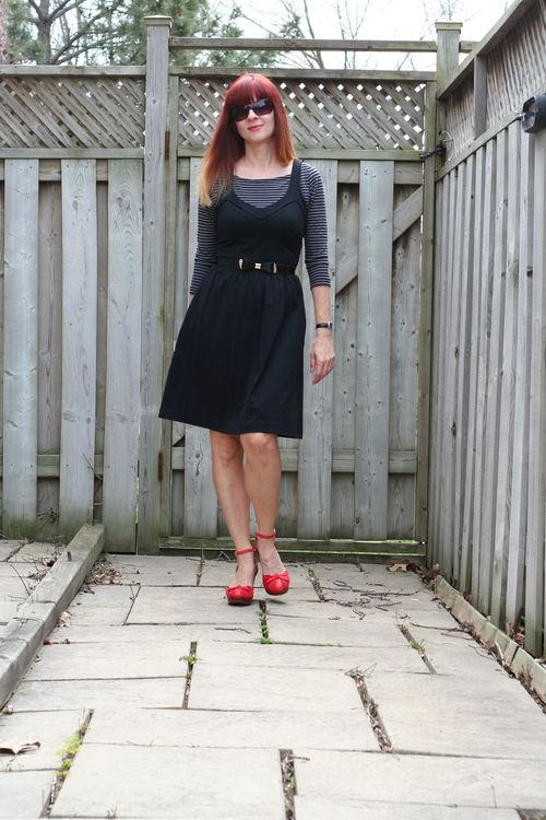 Little black dress with striped top and red shoes